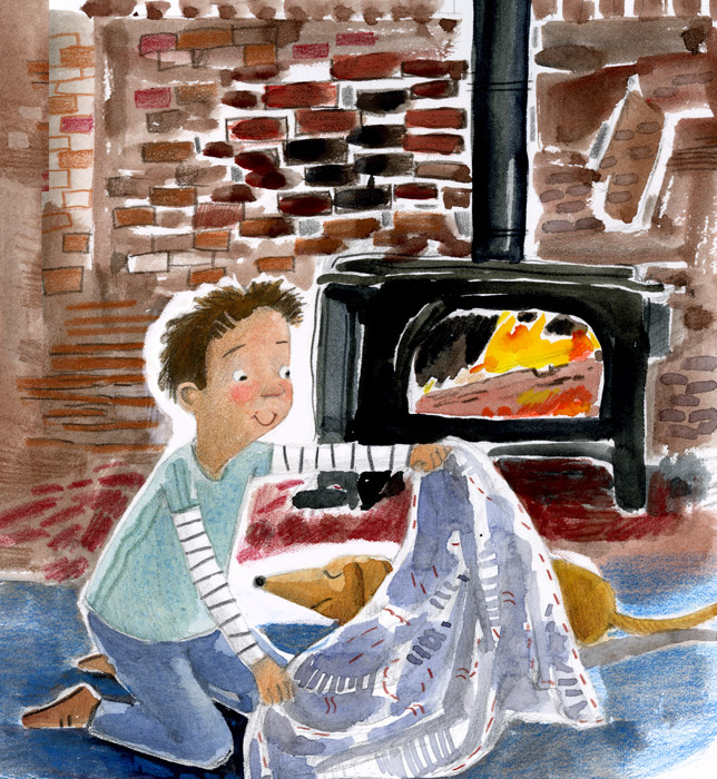 Boy in front of stove is putting a blanket over dog.